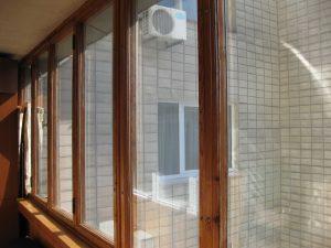 daugiabuciu-balkonu-stiklinimas-medine